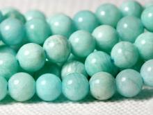 Бусина круглая гладкая, камень-амазонитнатуральный,цвет-сочный бирюзово-голубой теплый, неоднородный, со светлыми полупрозрачными прожилками.
