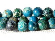 Бусина-шарик гладкий, камень варисцит натуральный, тонирован в теплый сине-голубой.