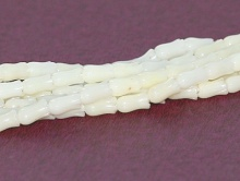 Коралл маленький тюльпан белый 6.5х3.25х3.8 мм. мм.