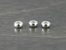Бусина мелкая распорка-разделитель из серебра  92.5%.. вн. отв. 0.55 мм.