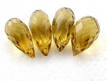 Топаз золотистый 11-14х5-6 мм.