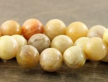 Средние бусины круглые кремовой окраски, диаметр–10.3 (+-0,2) мм. вн.отв. 1,1 мм. природный натуральный камень- пейзажная яшма натуральная,