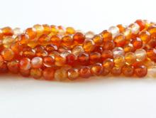 Мелкая бусина круглаяограненная,камень-сердоликнатуральный, цвет-оранжево-золотистый, неоднородный,размер–4 мм.