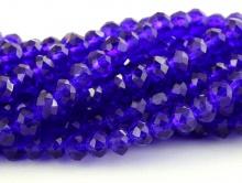 Бусины стеклянные средние, рондели огранённые, цвет бусин-прозрачный синий с фиолетовым оттенком,