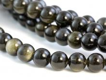 Бусиныкруглые полированные, камень натуральный–обсидиан черный переливчатый.Цвет-черный с шелковистым переливом темно-болотного цвета.