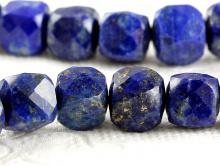 Камень натуральный-лазурит, бусина формы кубик ограненный, цвет-сине-фиолетовый с пиритовыми и белыми природными включениями.