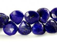 Бусина–ограненная формы широкого лепестка, камень-лазурит натуральный, цвет-синий холодный с природными включениями пирита