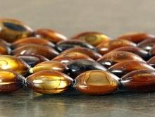 Бусины полированные из тонированного натурального перламутра,  цвет-золотисто-коричневый с перламутровым отливом, Форма-рис