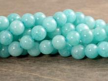 Бусина круглая гладкая, камень-амазонит натуральный, цвет-сочный бирюзово-голубой теплый, неоднородный, со светлыми прожилками.