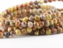 Бусины из натуральной яшмы, круглые пестрой окраски, диаметр–6 мм. вн.отв. 0,8 мм., природный натуральный камень. Цвета-основные: коричневый, бежевый, серый, терракотовый.
