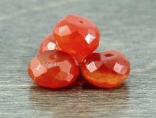 Камень-сердолик натуральный, бусина рондель огранённая.Цвет-ярко оранжевый, полупрозрачный.