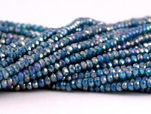 Рондели мелкие-бусины стеклянные огранённые, размер: 2,5х1.6 мм. (+- 0,1 мм.). вн.отв. 0,5 мм. Цвет бусин-полупрозрачный, сине-зелёный, с радужным переливом,