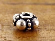 Гранулированная бусина серебряная 8.5х4 мм.