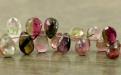 Цвет-розовый с зеленым, с природными включениями, характерным строением камня, размер-8.5х5.7х3 мм.