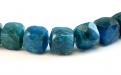 Бусины огранённые, камень-апатит натуральный, форма бусин-кубик огранённый.Цвет-сочный сине-голубой теплый, неоднородный с природными включениями,