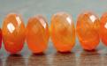 Бусина из сердолика огранённая рондель, цвет-сочный оранжевый, полупрозрачный.