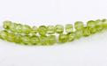 Камень-хризолит (пироп) натуральный, форма бусин-кубик огранённый.Цвет-теплый зелёный,