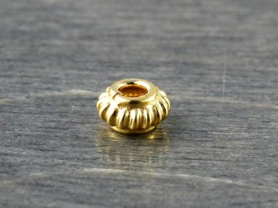 Бусина-распорка позолоченная из стерлингового серебра, размер – 3х4.8 мм. вн. отверстие 2,1 мм.,